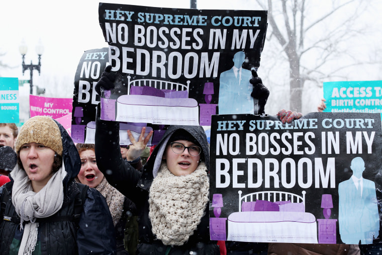 Demonstrators rally outside of the U.S. Supreme Court during oral arguments in Sebelius v. Hobby Lobby, March 25, 2014.