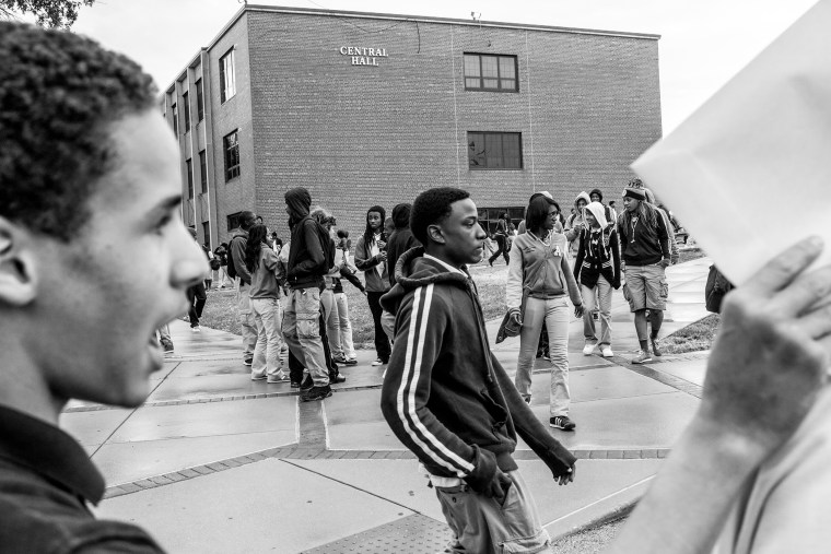 A group of students outside of Normandy High School just moments after the bell rang at the end of school in Wellston, St. Louis County, Mo.