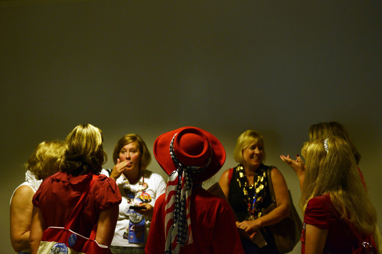 Women confer in the hallway at the Tampa Bay Times Forum in Tampa, Florida, on August 30, 2012 before the day's Republican National Convention events.