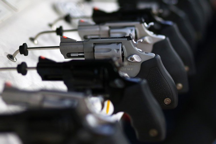 Handguns are seen on display at an event in Houston, Texas.