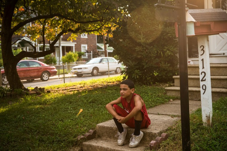 A boy sits on his front steps on August 20, 2013 in the Fairview neighborhood of Camden, New Jersey.