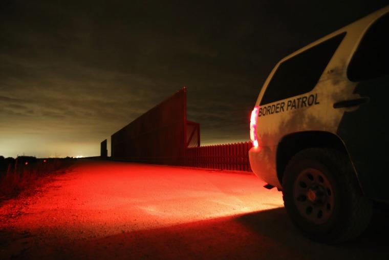 A U.S. Border Patrol vehicle stops near a section of the U.S.- Mexico border fence on April 10, 2013 in La Joya, Texas.