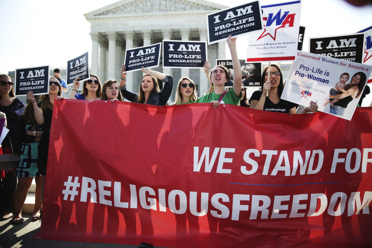 Activists gather outside the Supreme Court building Monday morning in Washington, June 30, 2014.