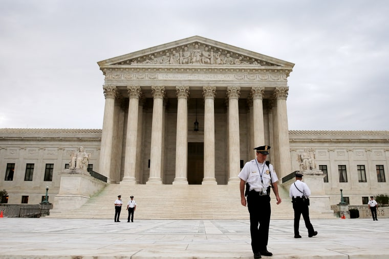 Police stand in front of the U.S. Supreme Court on June 30, 2014 in Washington, DC.