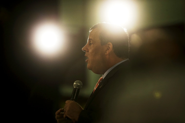 New Jersey Gov. Chris Christie, center right, addresses a gathering at a town hall meeting Wednesday, June 25, 2014, in Haddon Heights, N.J.