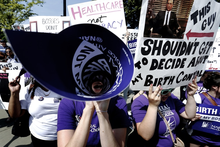 Demonstrators in support of abortion and contraceptive rights chant in suport of their cause after the Hobby Lobby ruling outside the U.S. Supreme Court in Washington