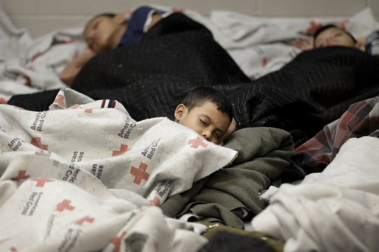 Detainees sleep in a holding cell at a U.S. Customs and Border Protection processing facility, Wednesday, June 18, 2014, in Brownsville,Texas.