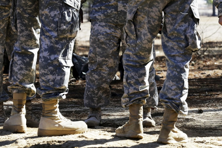 Troops stand at Fort Bragg, North Carolina, Feb. 18, 2014.
