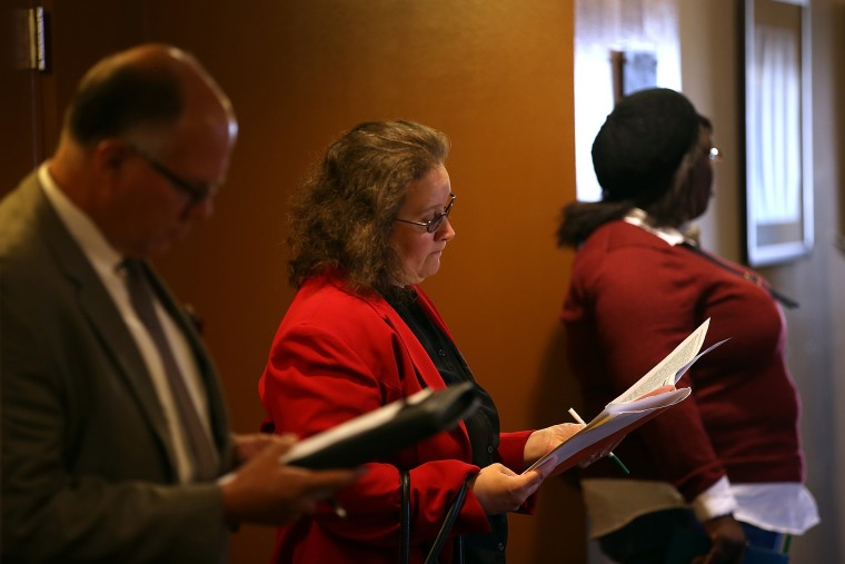 Job seekers fill out applications before the start of the HireLive career fair on June 4, 2014 in San Francisco, Calif.