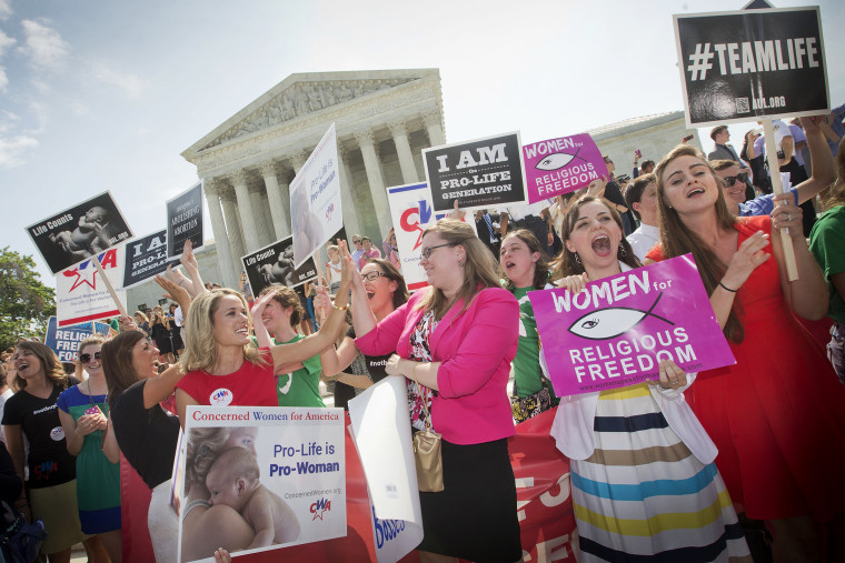 Demonstrators react to hearing the Supreme Court's decision on the Hobby Lobby case outside the Supreme Court in Washington, D.C., June 30, 2014.