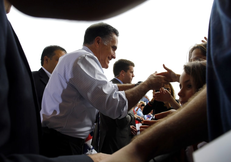 Republican presidential nominee Romney greets audience members at a campaign rally at the airport in Sanford