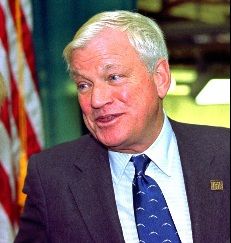 In this Oct. 23, 1997, file photo, billionaire Richard Mellon Scaife, owner and publisher of the Tribune Review newspapers in Pittsburgh and Greensburg, Pa., greets visitors as they enter the paper's new facility in Warrendale, Pa. during the dedication o