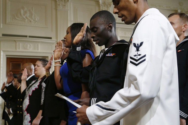 Members of the U.S. military and military spouses recite the Oath of Allegiance to become naturalized U.S. citizens during a ceremony hosted by U.S. President Barack Obama (not pictured) at the White House in Washington July 4, 2014.