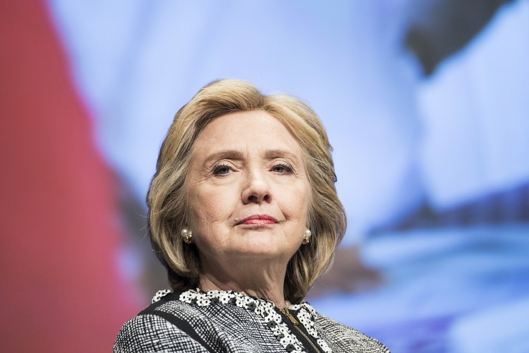 Former Secretary of State Hillary Clinton waits to speak at the World Bank May 14, 2014 in Washington, D.C.