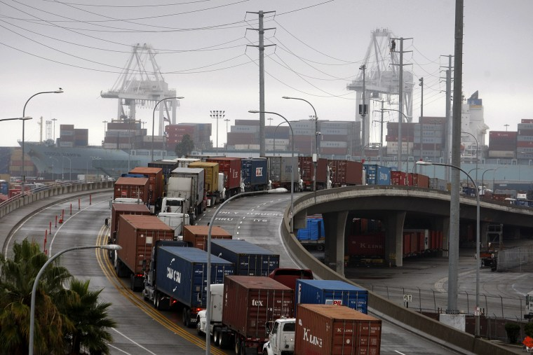 Shipping container trucks sit in traffic at the seaport, Nov.  29, 2012 in Long Beach, Calif.