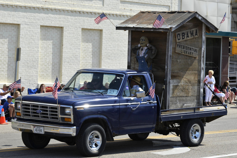 """A float with the words \""""Obama Presidential Library\"""" is seen during the Fourth of July parade in downtown Norfolk, Neb. July 4, 2014."""