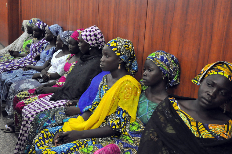 Schoolgirls who have escaped from Boko Haram kidnappers in the village of Chibok, sit at the Government house to speak with State Governor Kashim Shettima in Maiduguri on June 2, 2014.