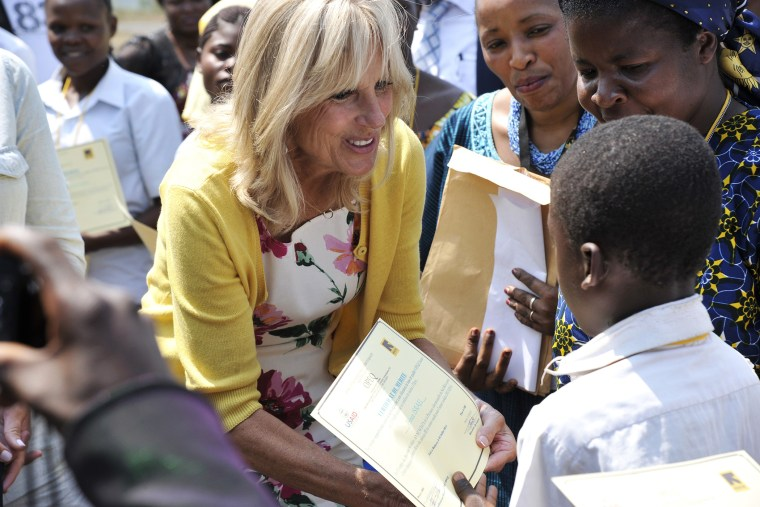 Dr. Jill Biden, wife of the US vice-president, hands a diploma to a student as representatives of the Anunciata non-governmental organization (NGO) look on, after she arrived at the airport of Bukavu, in eastern Democratic Republic of Congo, on July 5, 20