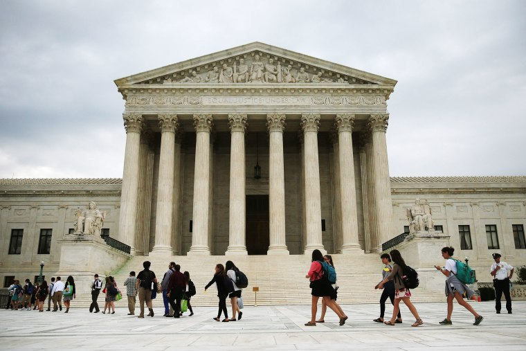 People arrive to attend the final session of the term at the U.S. Supreme Court on June 30, 2014 in Washington, DC.