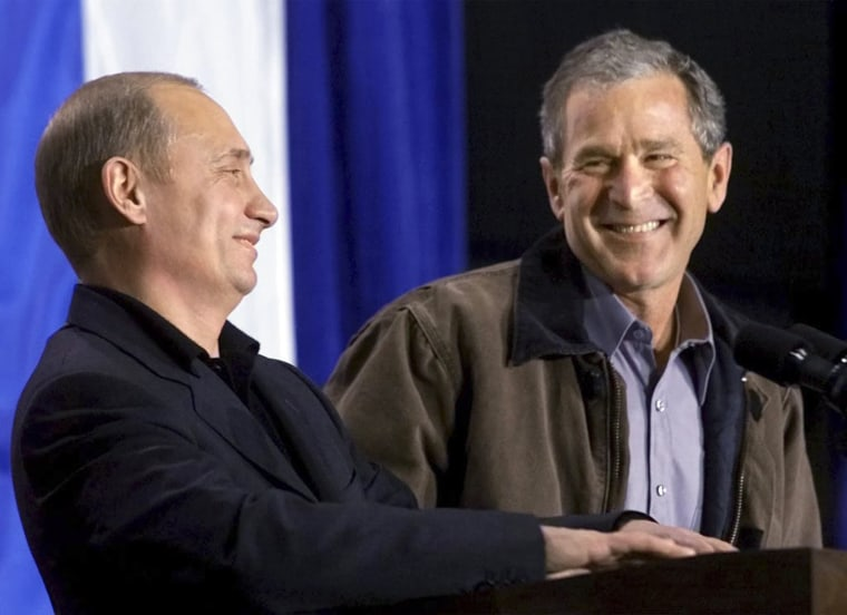 U.S. President George W. Bush shares a laugh with Russian President Vladimir Putin in Crawford, Texas, in this November 15, 2001 file photo.