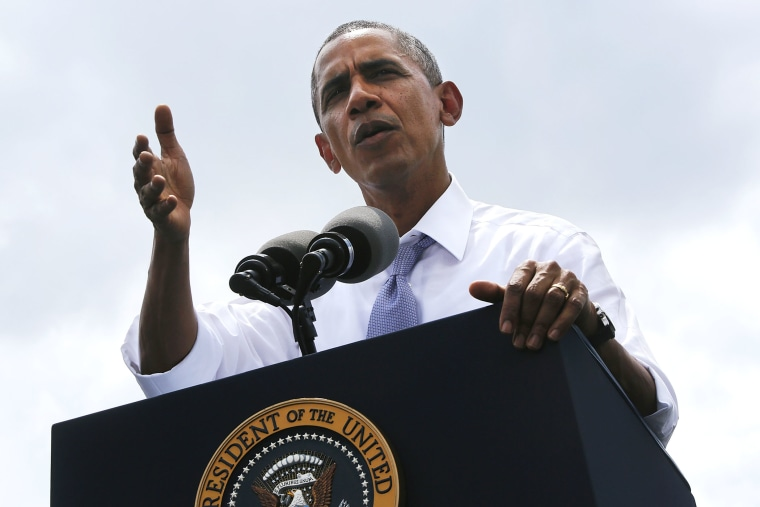U.S. President Barack Obama delivers remarks at the Georgetown Waterfront Park in Washington, July 1, 2014.