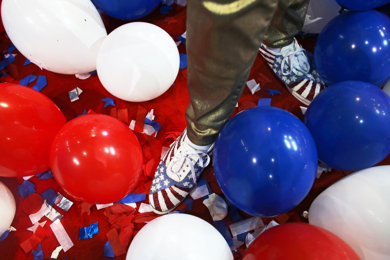A person stands in balloons during the 2012 Republican National Convention in Tampa, Florida.