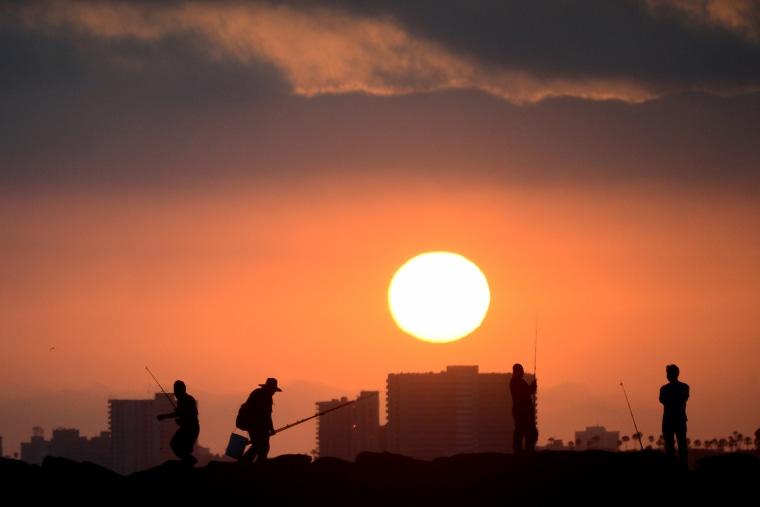 Fishermen at Seal Beach, California