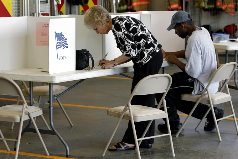 Voters cast their ballots at Clayton Fire Station in downtown Clayton, N.C. on May 6, 2014.