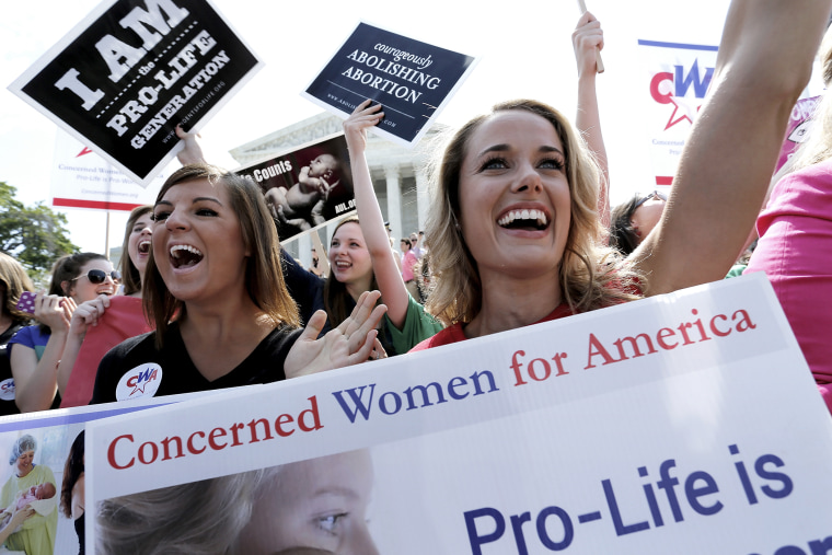 Demonstrators cheer as the ruling for Hobby Lobby was announced outside the U.S. Supreme Court in Washington