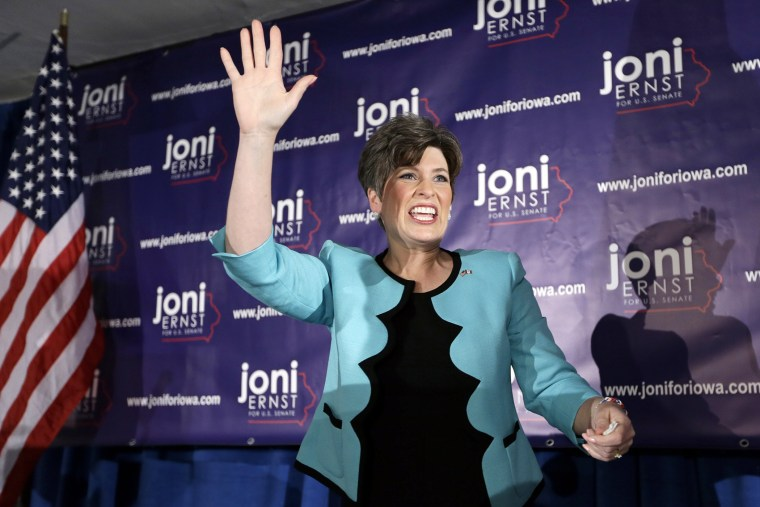 State Sen. Joni Ernst waves to supporters at a primary election night rally, June 3, 2014, in Des Moines, Iowa.