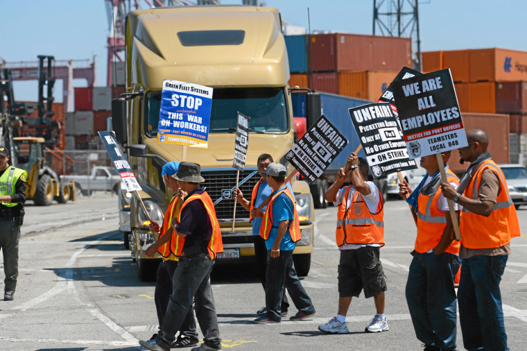 Members of the Teamsters Union picket at LBCT in the Port of Long Beach, Calif., in support of a strike by port truck drivers on July 8, 2014.
