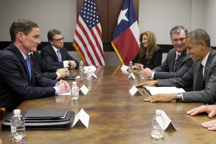 President Barack Obama attends a meeting about the border and immigration with local elected officials and faith leaders at DalFort Fueling in Dallas, Wednesday, July 9, 2014.