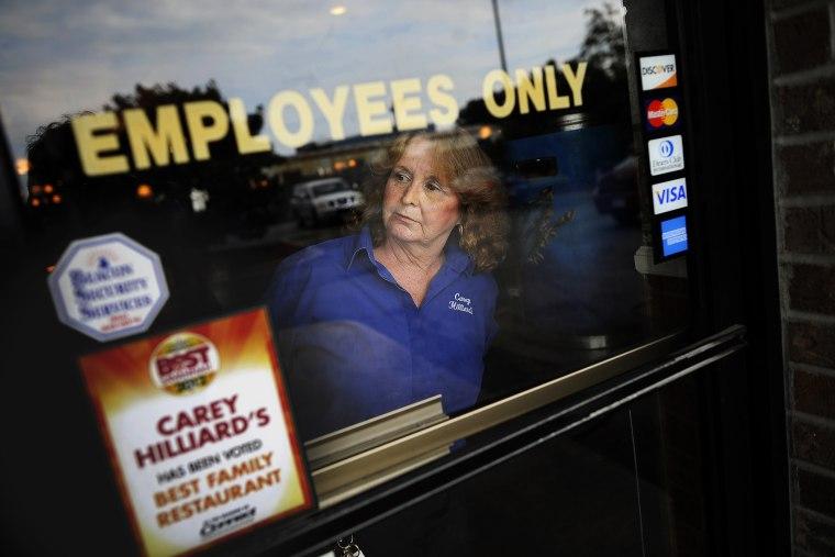A waitress looks outside in Savannah, Ga., Oct. 28, 2013.