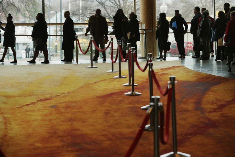 About 1,500 people seeking employment wait in line to enter a job fair, March 28, 2014 in Washington, D.C.