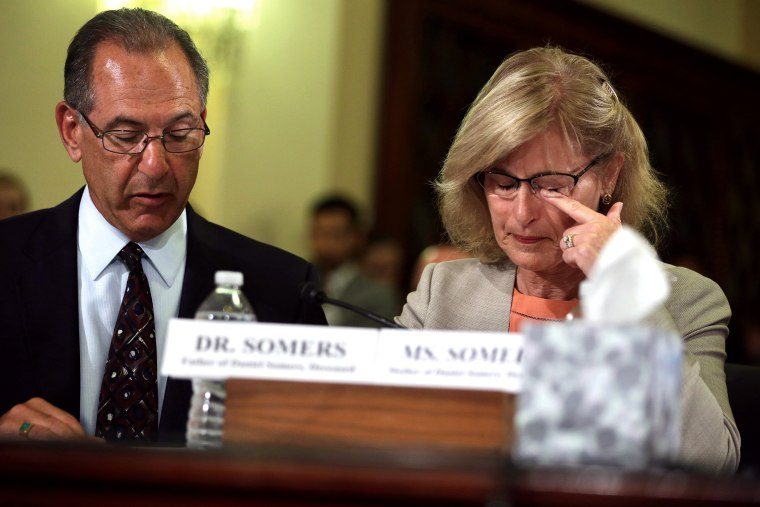 Jean Somers (R), whose son Daniel took his own life after he returned from a second deployment in Iraq, wipes tears during a hearing on Capitol Hill in Washington, DC.