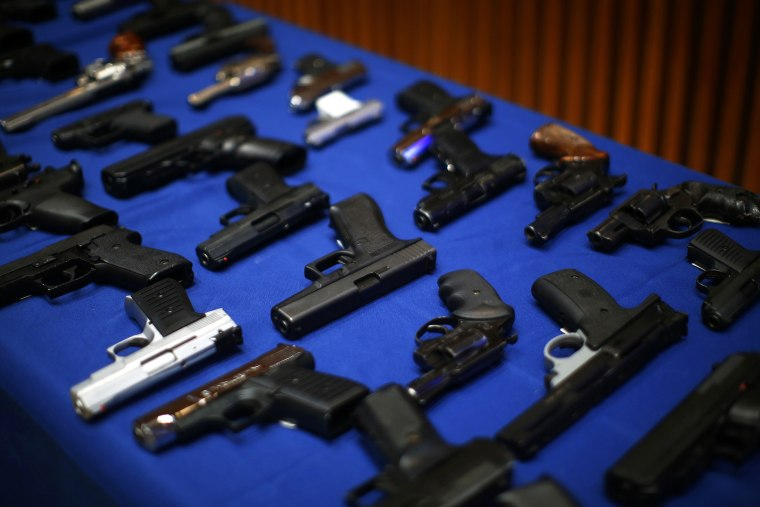 Seized guns are pictured at the police headquarters in New York, N.Y., Aug. 19, 2013.