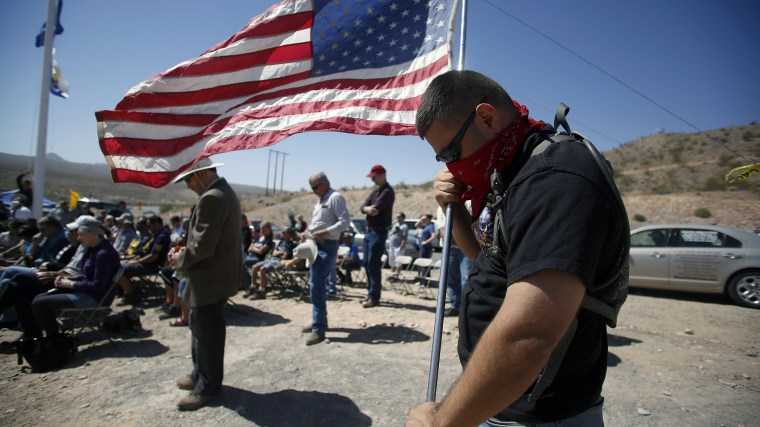 A protestor prays during a roadside church service at a protest site in Bunkerville, Nevada