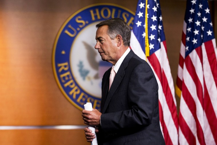 John Boehner leaves a news conference on Capitol Hill in Washington, Thursday, July 10, 2014.