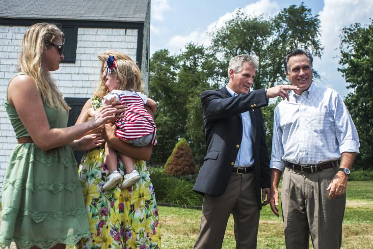 Mitt Romney speaks with Scott Brown in Stratham, N.H., July 2, 2014.
