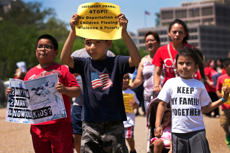 Young children join immigration reform protesters while marching in front of the White House July 7, 2014 in Washington, DC.