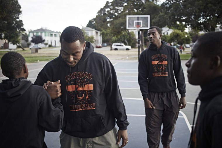 William Blackwell mentors 10th grade students at De Fremery Park in West Oakland, California, on July 7, 2014.
