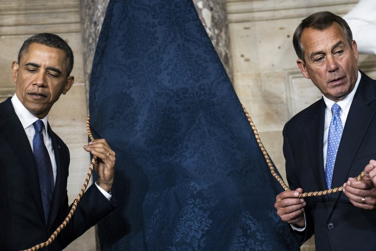 President Barack Obama (L) and Speaker of the House John Boehner (R-OH) wait to unveil a statue of Rosa Parks during an unveiling in Statuary Hall on Capitol Hill, Feb. 27, 2013 in Washington, D.C.