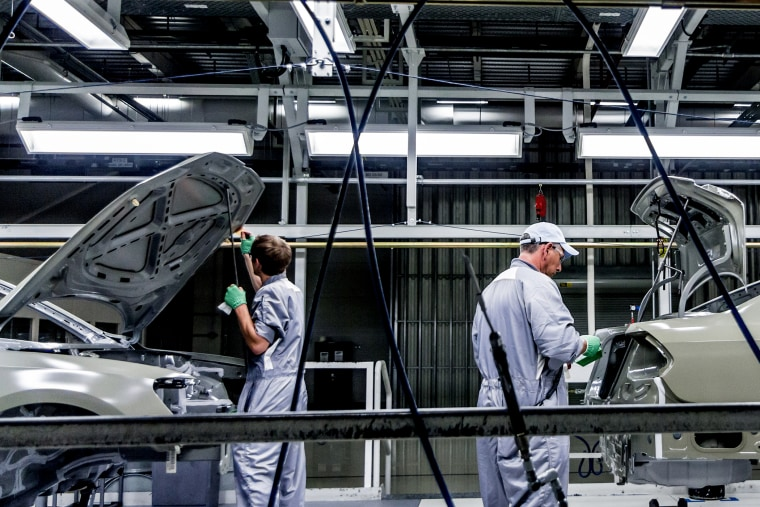 Workers assemble Volkswagen Passat sedans at the German automaker's plant in Chattanooga, Tenn. on June 31, 2012.