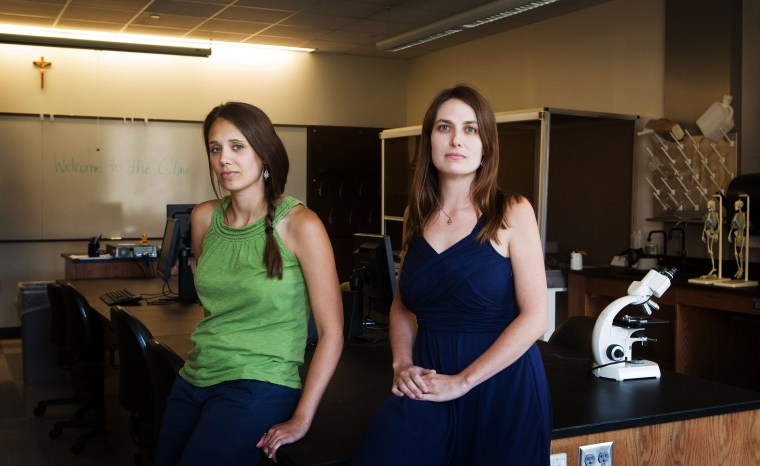 Notre Dame graduate students Laura Grieneisen, at right, and Liz Miller pose for a portrait inside of the Jordan Hall of Science on the University of Notre Dame's campus near South Bend, Indiana on July 10, 2014.