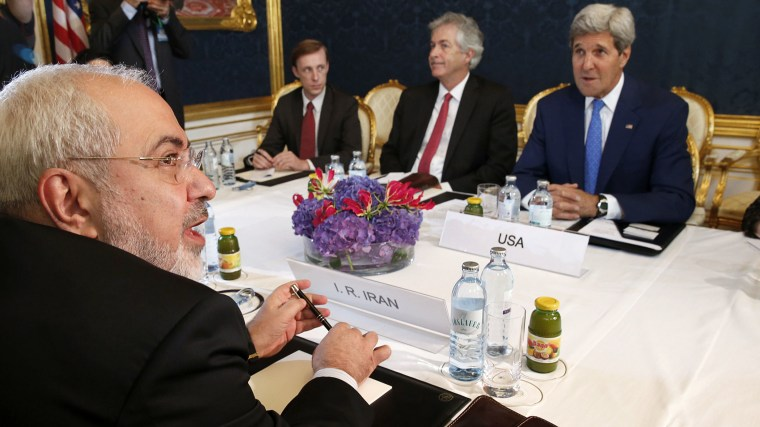 Iran's Foreign Minister Javad Zarif (L) holds a bilateral meeting with US Secretary of State John Kerry (R) on the second straight day of talks over Tehran's nuclear program in Vienna, on July 14, 2014.