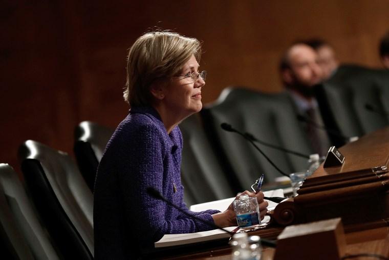 Sen. Elizabeth Warren (D-MA) listens during a hearing, Nov. 12, 2013 in Washington, D.C.