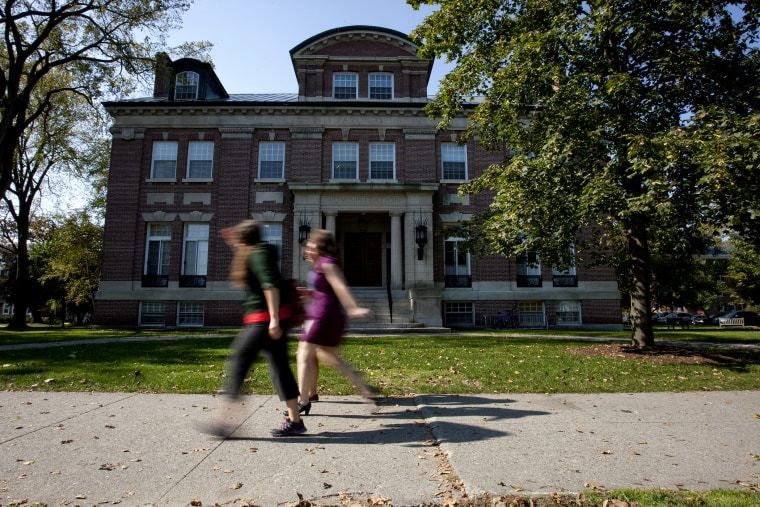 Students walk past an administration building on the Dartmouth College campus.