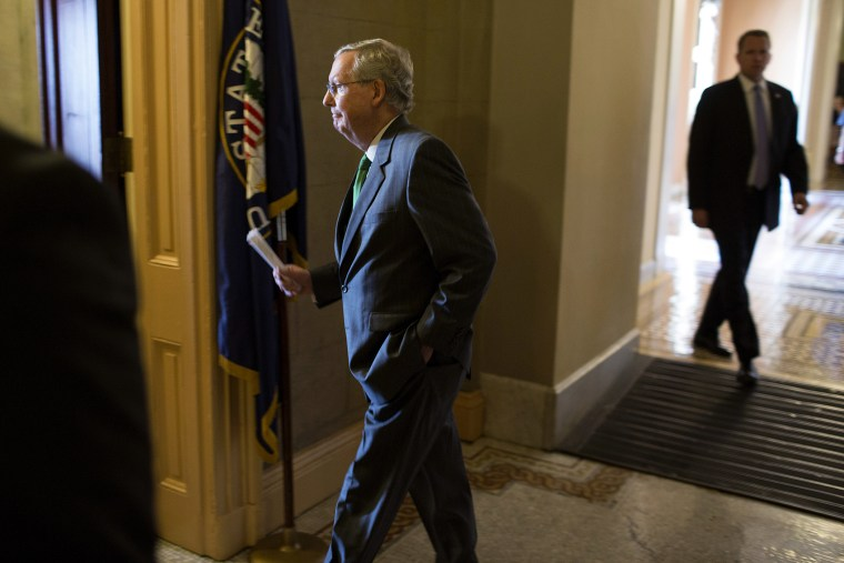 Senate Minority Leader McConnell (R-KY) returns to his office after the Republican caucus meeting on Capitol Hill in Washington