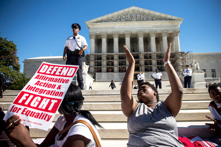 Students protest in support of affirmative action outside the Supreme Court, October 15, 2013 in Washington, DC.