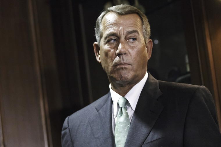House Speaker John Boehner of Ohio meets with reporters in Washington, July 15, 2014.